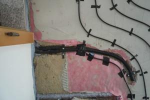 Elektroheizung, Elektrische Fußbodenheizung mit Bodenfühler (schwarzes Rohr)